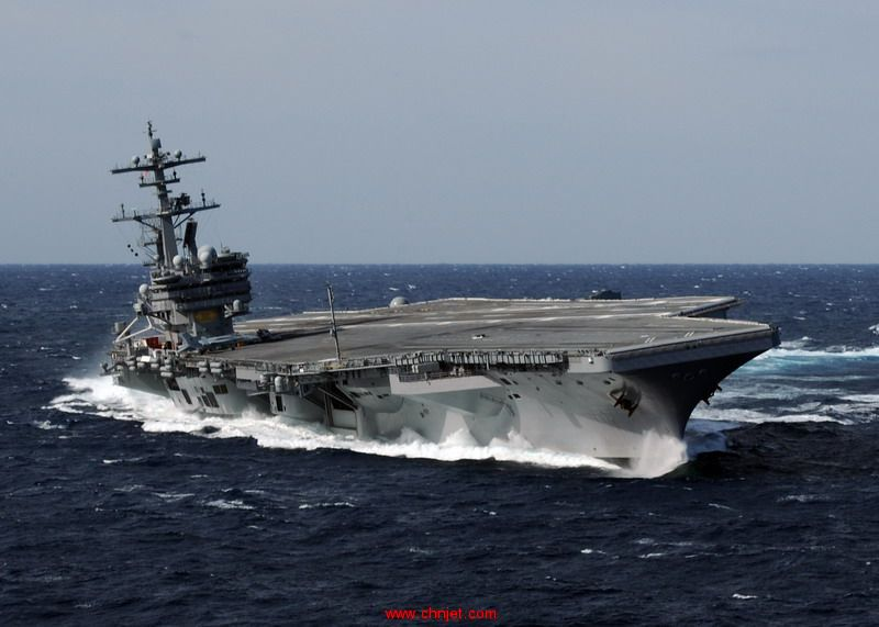 US_Navy_100227-N-4408B-613_USS_George_H.W._Bush_(CVN_77)_heels_hard_to_starboard_during_high-speed_drills.jpg
